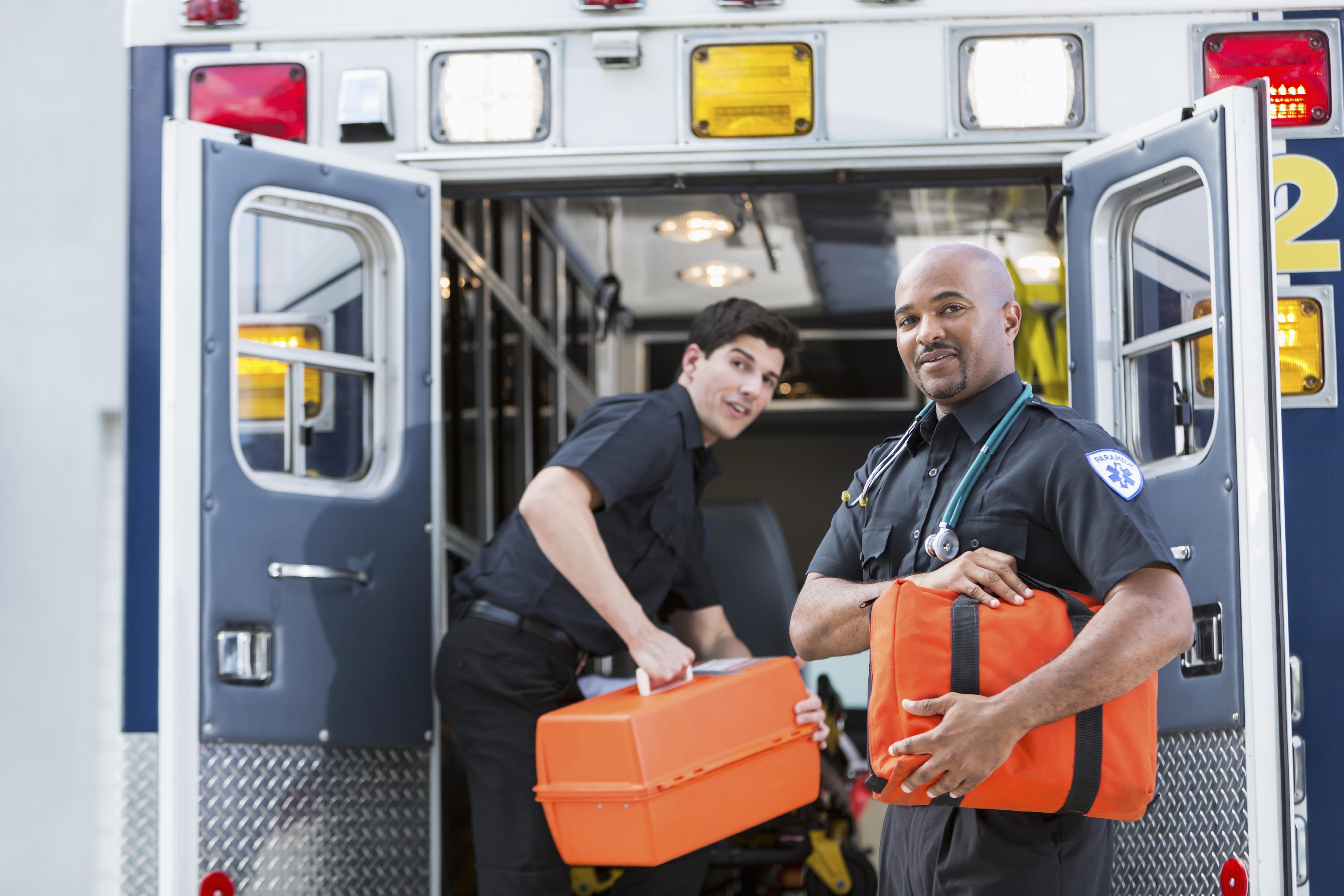Paramedics at back of ambulance