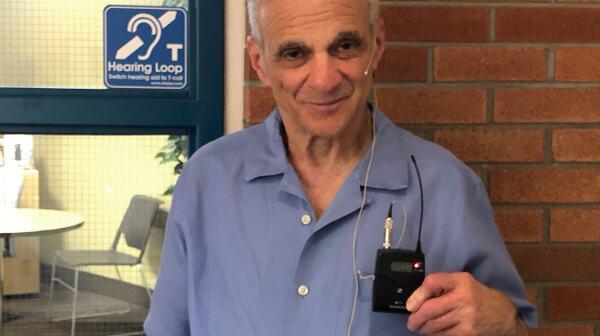 Photo of Harry Wolfe wearing headset.jpg