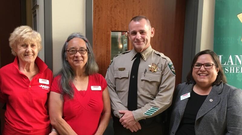 Charlott, Junko & Carmel with law enforcement.jpg